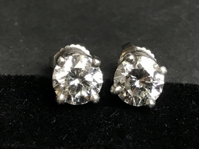 Pair of stud diamond earrings, GIA, 2.1 dwts
