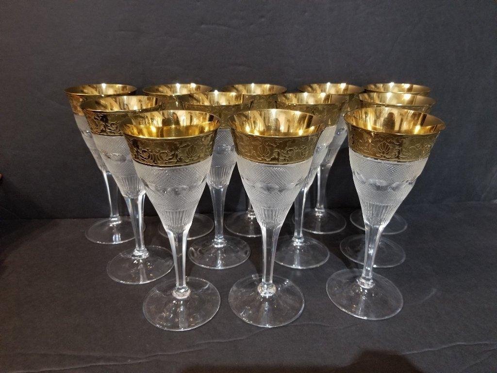 Twelve engraved gold rimmed glasses in 2 trays