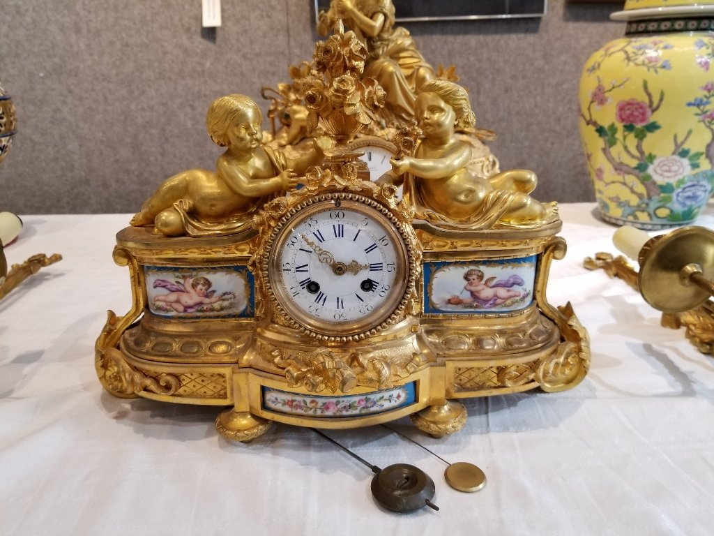 Gilt bronze French clock with cupids, c.1900