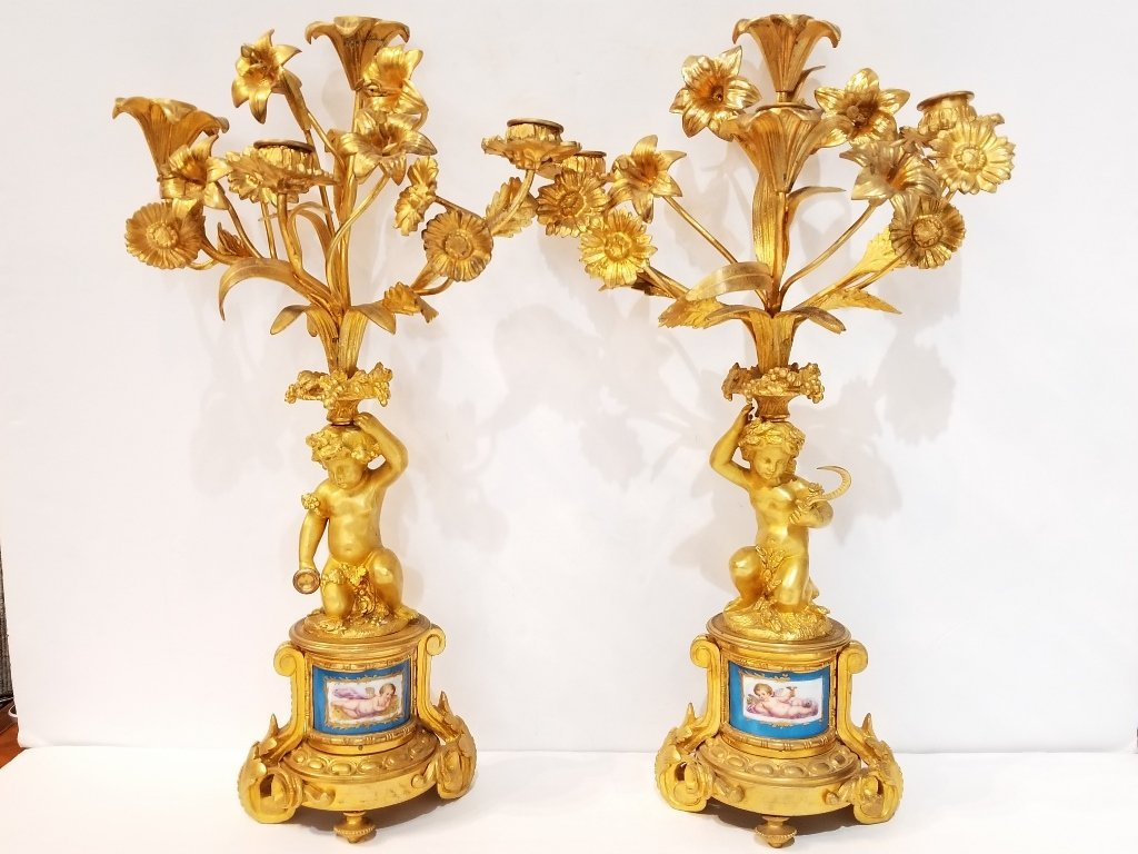 Pair of gilt bronze cherub candle holders w/porc