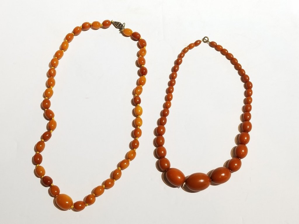 Box lot-Two amber necklaces