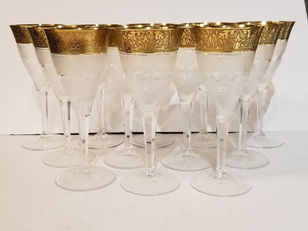 Twelve engraved Moser glasses in 2 trays