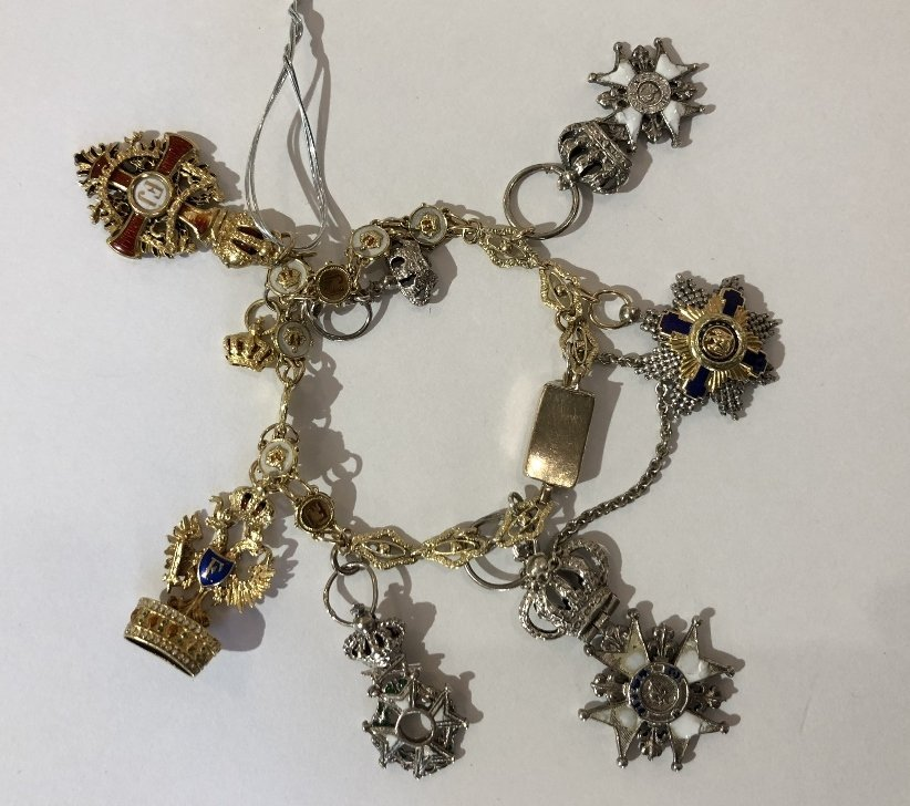 Military gold charm bracelet with medals, as is