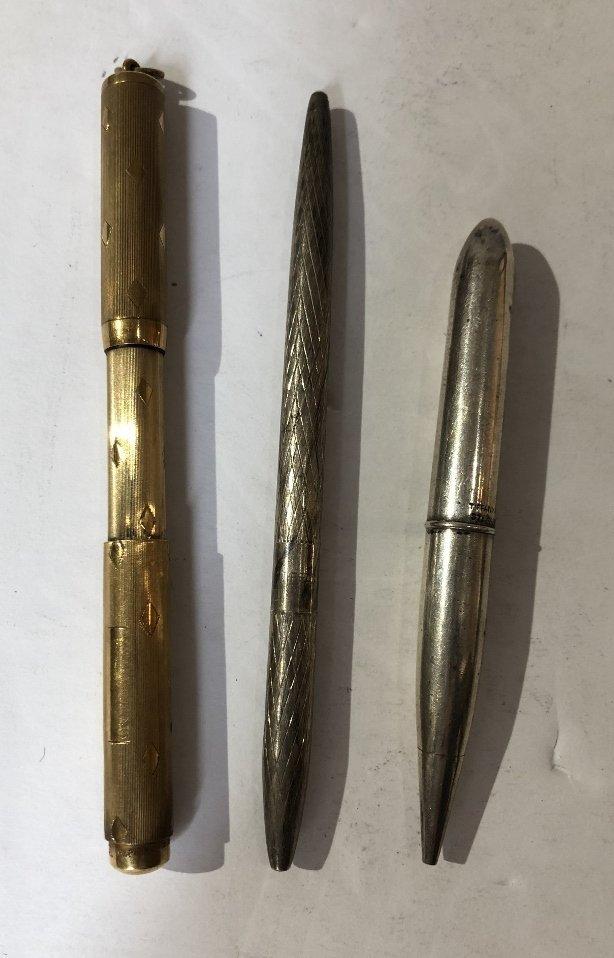 One 14k pen, two Tiffany & Co sterling pens