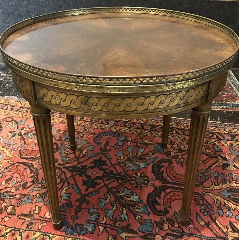 Circular wood table with gallery