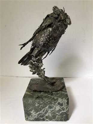 Sterling silver statue of owl by Xavier Gonzalez