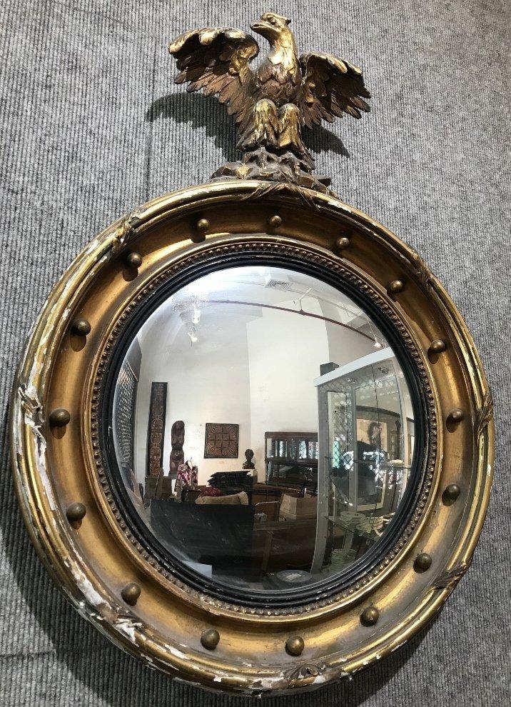 Convex mirror in gilt wood eagle frame