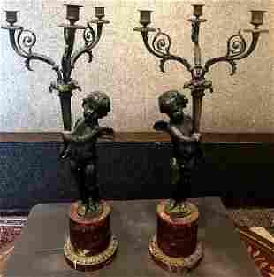 Pair of bronze cherub lamps, c.1900