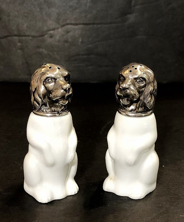 KPM and 800 silver salt and pepper dogs, c.1920