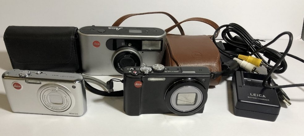 Three modern Leica cameras and chargers