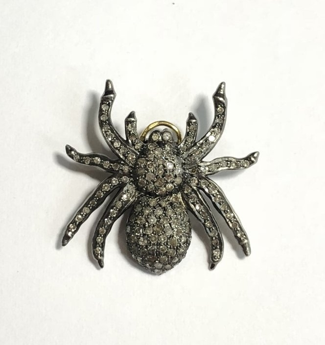 Silver and diamond spider pendant, 2.5 dwts