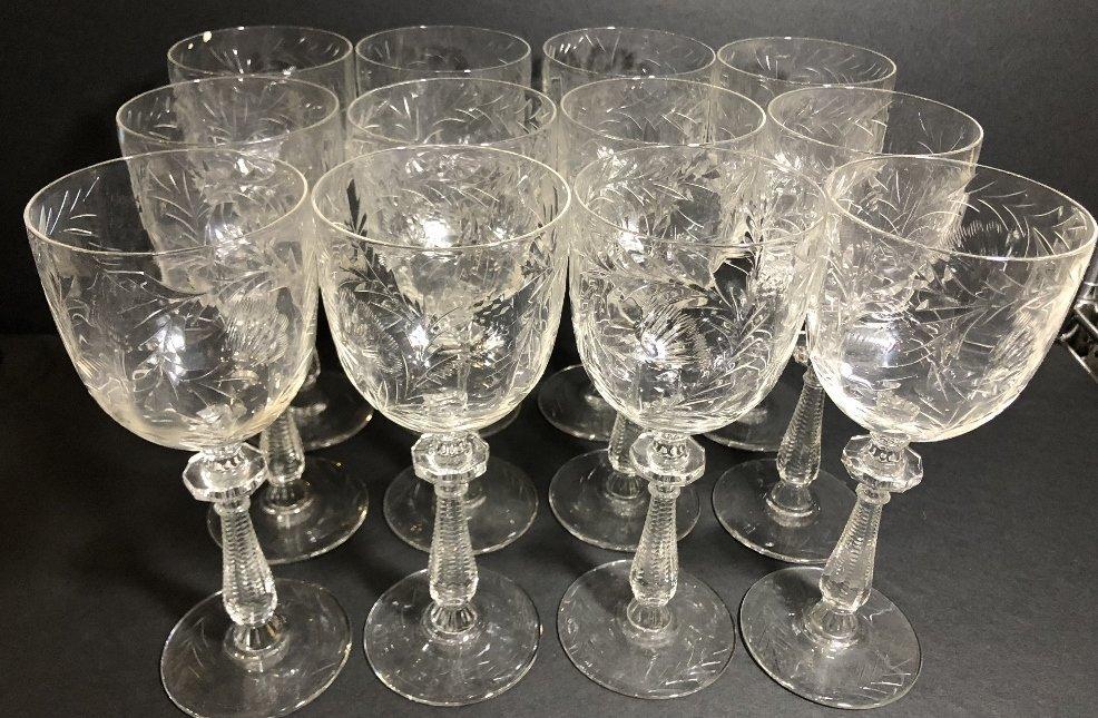 Twelve engraved wine glasses, circa 1930