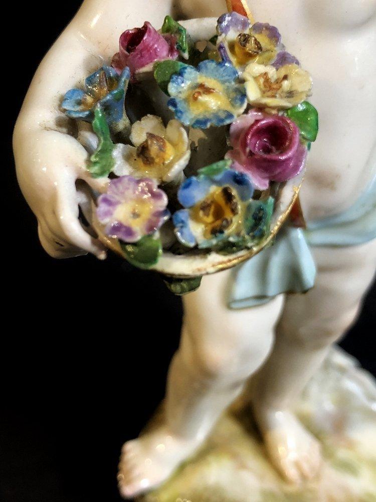 Meissen fig.,putti offering flowers, c.1900 - 8