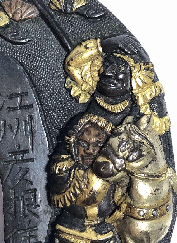 Iron, gold and mixed metal Tsuba,c.1890 - 7