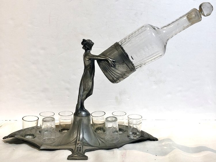 WMF figurine woman holding decanter with glasses