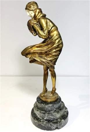 Art Deco style figurine of winter girlfaux ivory
