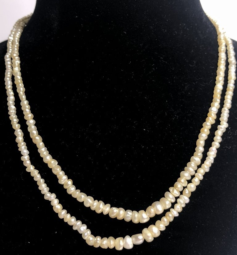 Strand of pearls with antique diamond clasp