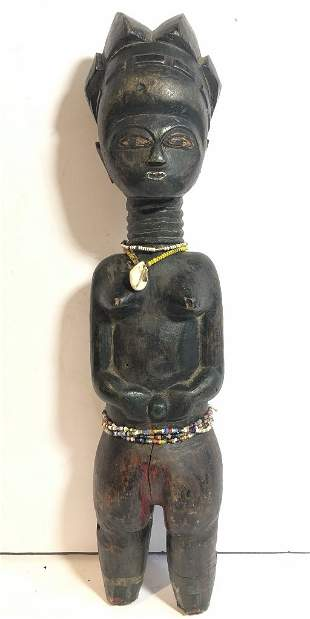Tribal wood figure with necklace