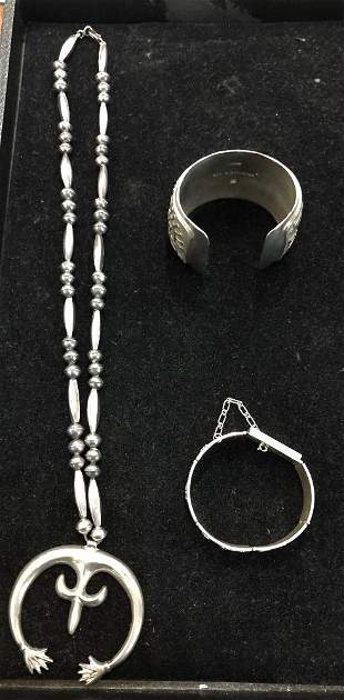 Three pieces of silver jewelry, one by Ben Nighthorse