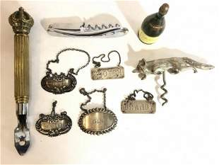 Silver wine labels and bar items