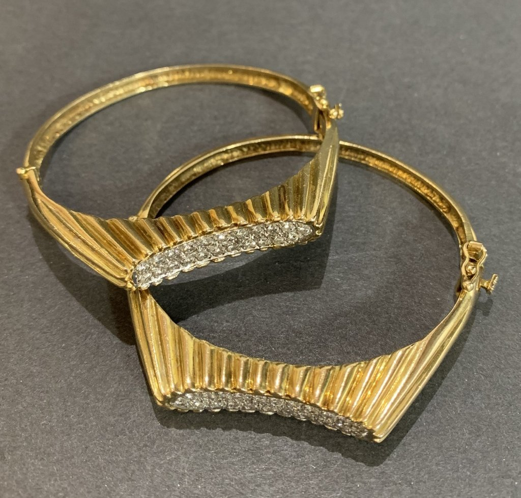 Pair of 14k gold and diamond bracelets 31 dwt