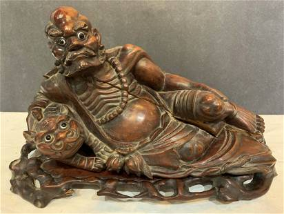 Chinese wood carving demon and dog cracks