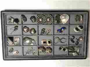 Twenty pairs of silver earrings