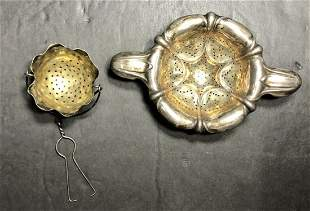 2 silver tea strainers,one Shiebler,22nd st, 1.8t.oz