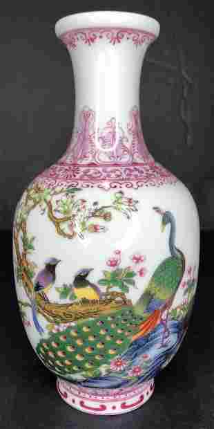Small pink and white Chinese vase with writing