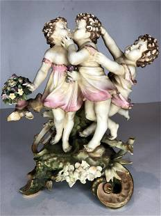 Porcelain fig three children playing c1900