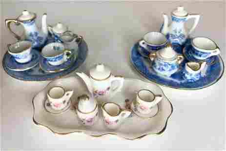 Three miniature tea sets