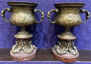 Pair of bronze and red marble urns with lions, 19thc
