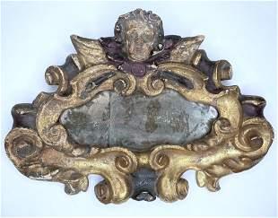 18th century gilt wood mirror, angel face