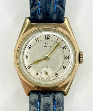 9k gold Omega mans wrist watch with date of 1938