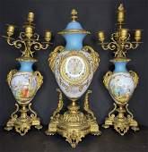 Sevres porcelain clock set with ram heads.c1880
