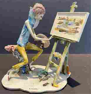 Ceramic statue of artist by Adriano Colombo