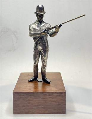 Sterling silver statue of rabbit hunter, c.1910