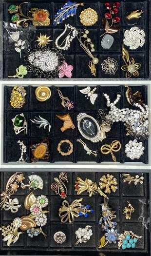 Fifty-four costume brooches,Estate of the Twins