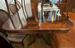 Rosewood dining room table with leaves