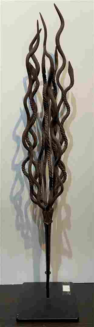 Tribal metal torch sculpture