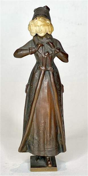 Bronze of girl by Ferdinand Lugerth, carved face