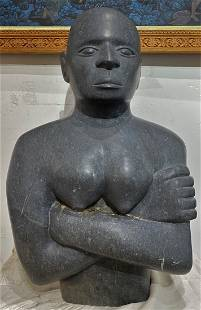 Stone sculpt of African youth, folded arms, signd Suret