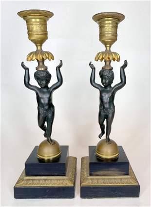 Pair of gilt bronze putti candlesticks