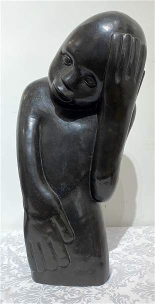 Stone African sculpture of troubled youth