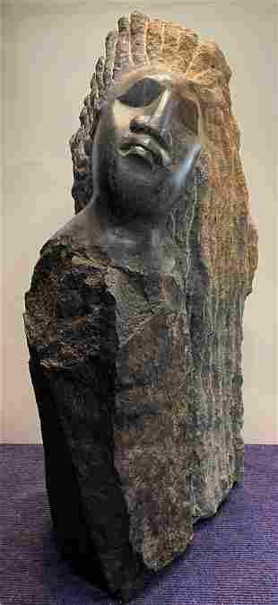 Grey, brown, & orange stone face sculpture,Zimb