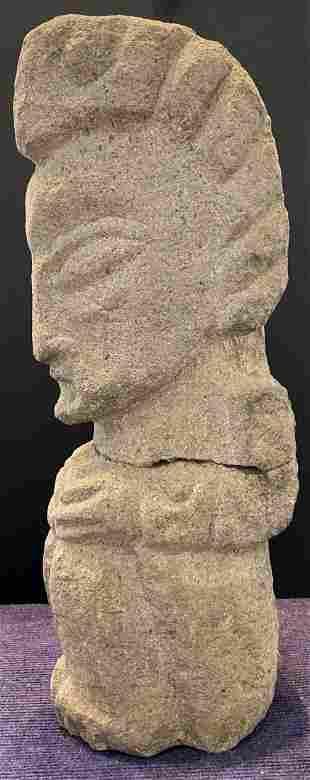 Grey stone triangular face sculpture with break