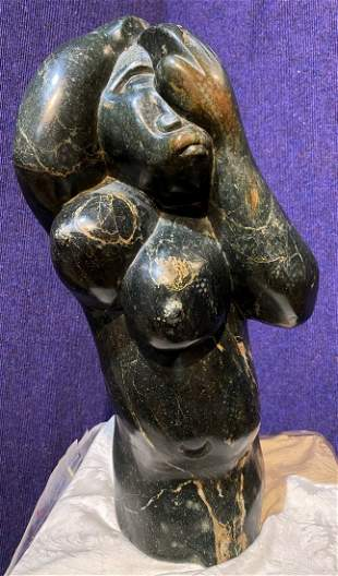 Tribal stone sculpture by Josiah Manzi, female figure