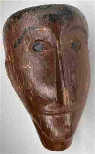 Wooden tribal head sculpture