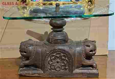 Glass table with carved Indian wood animal base