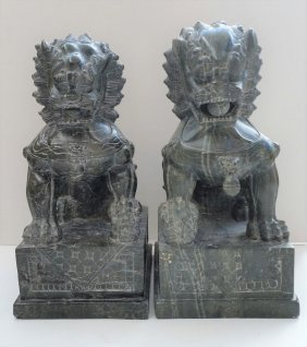 2 FOO DOGS ASIAN SCULPTURES STONE SIGNED BY THE ARTIST.